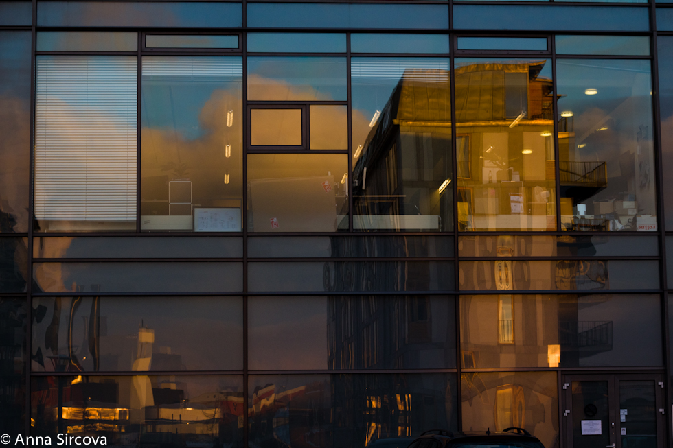 reflecting Copenhagen cityscape in a glass building