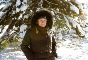 my mom next to a big pine tree, covered with snow, Umea, Sweden
