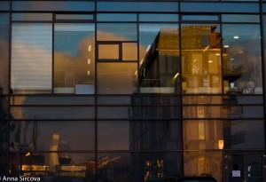 reflecting Copenhagen cityscape in a glass building