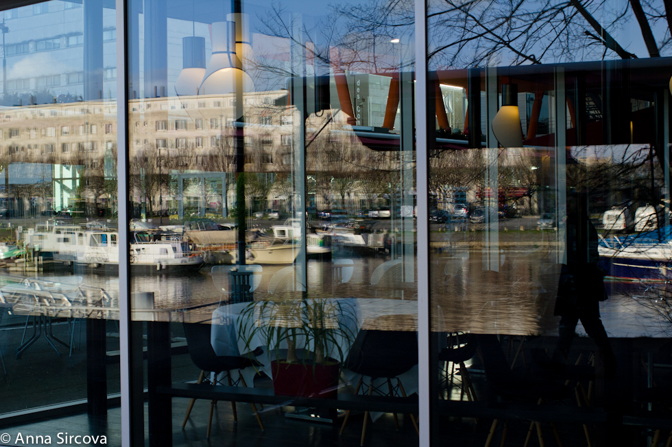 reflections in the cafe window on the streets of Nantes, reflecting river and boats